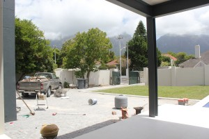 View from patio onto the driveway and lawn