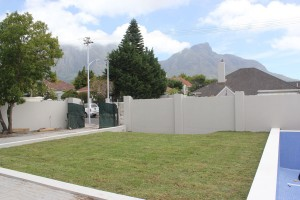 The new lawn and newly built, unfinished wall
